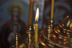 Burning candle in a candelabrum Stock Images