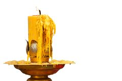 Burning of candle on candlestick Stock Photos