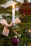 Burning candle christmas decoration Stock Photo