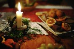 Burning candle in Christmas decoration Stock Photo