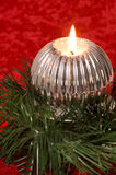 Burning candle with Christmas decorations Royalty Free Stock Images