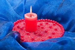Burning candle with christmas decorations Stock Images