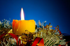 Burning candle with Christmas decorations Royalty Free Stock Photo