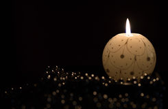 Burning candle and Christmas decorations Stock Image