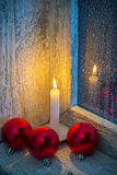 Burning candle and Christmas ornaments Royalty Free Stock Photography