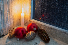 Burning candle and Christmas ornaments Royalty Free Stock Image