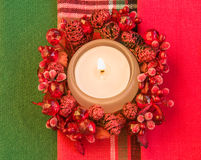 Burning candle. Christmas theme. Stock Photos