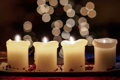 Burning candle with christmas tree bokeh Royalty Free Stock Image