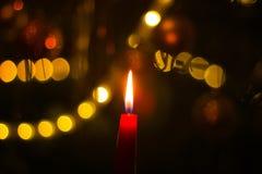 Burning candle on Christmas tree Stock Photo