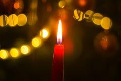 Burning candle on Christmas tree Royalty Free Stock Photos