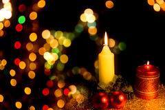 Burning candle with Christmas-tree decoration Royalty Free Stock Photos
