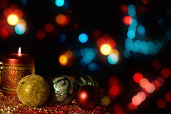 Burning candle with Christmas-tree decorations stock photo
