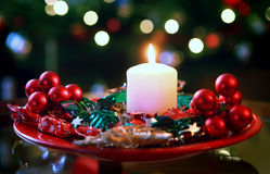 Burning candle on christmas wreath Royalty Free Stock Image