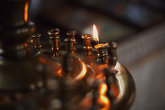 Burning candle in church Royalty Free Stock Image