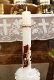 Burning candle at the communion Royalty Free Stock Photo