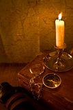 Burning candle and the compass Royalty Free Stock Images