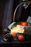 Burning candle and cones Royalty Free Stock Photography