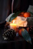 Burning candle and cones Royalty Free Stock Image