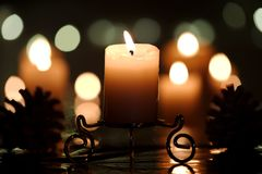 Burning candle with cones Stock Photos