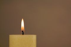 Burning candle with copy space Stock Image