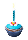 Burning candle on the cupcakes with decorations of mastic Royalty Free Stock Images