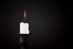 Burning candle on a dark background Royalty Free Stock Images