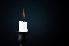 Burning candle on a dark background Royalty Free Stock Photos