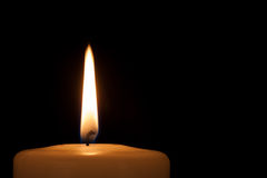 Burning candle in the dark with copy space Royalty Free Stock Image