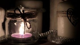 Burning candle in the dark stock video footage