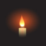 Burning Candle in the dark. Royalty Free Stock Photo