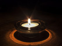Burning candle in the dark Stock Photography