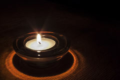 Burning candle in the dark Stock Image