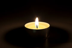Burning candle in the dark Royalty Free Stock Photography