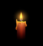 Burning candle in the dark. Stock Photography