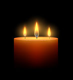 Burning candle in the dark. Royalty Free Stock Images