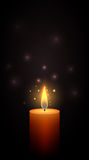 Burning candle in the dark. Royalty Free Stock Photography
