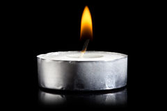 Burning candle in darkness Royalty Free Stock Images