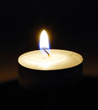 Burning candle in darkness Royalty Free Stock Image