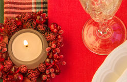 Burning candle on festive table. Christmas theme. Stock Photos