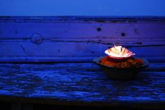 Burning candle and flowers. Close-up. Hinduism. Burning candle and flowers background. Close-up. Hinduism. Offering candle to Ganges River. Hinduism religious Stock Photos