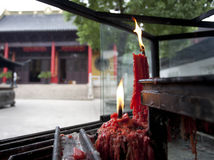 Burning candle in front of a chinese temple Royalty Free Stock Image
