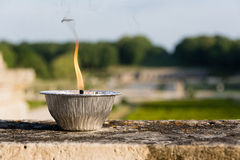 Burning candle in a garden Royalty Free Stock Photos