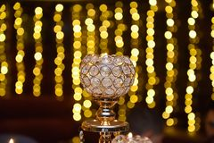 Burning candle in a glass candle holder with bokeh background royalty free stock photography
