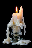 Burning candle in glass candlestick Royalty Free Stock Photography