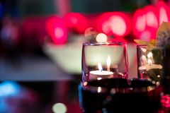Burning candle in glass cup Royalty Free Stock Photo