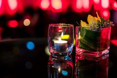 Burning candle in glass cup Royalty Free Stock Images