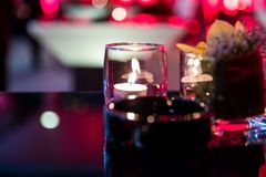 Burning candle in glass cup Stock Photo