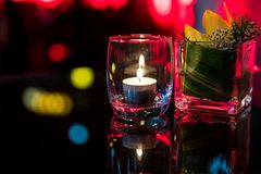 Burning candle in glass cup Stock Photography