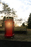 Burning candle on a grave Stock Photography