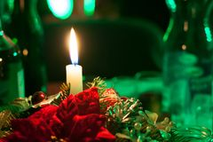 Burning candle with green background Royalty Free Stock Photography